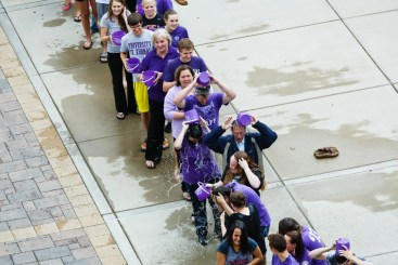 Seen from above, students, faculty and staff pour ice cold water on themselves. (Photo by Mark Brown)