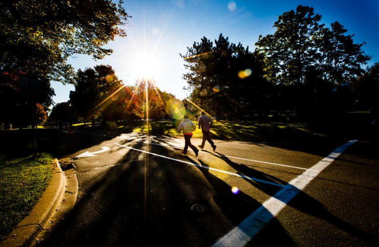 Runners head down Summit Avenue as part of the Wellness Center 5k Walk and Run. (Photo by Mike Ekern '02)