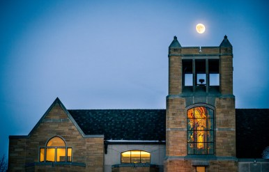 The moon hangs over O'Shaughnessy-Frey Library.