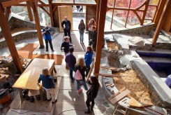 Steger shows guests the atrium space on the main level of his five-story, 5,000-square-foot wilderness center.