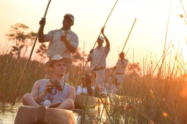 "Second Place, Tommies Abroad: Evan Keil, Botswana, Africa. ""Mokoro ride through the reeds: We were blessed with the opportunity to take a class in the heart of Botswana, Africa. We spent many days seeing firsthand the difficulties that Botswana has gone through and is currently facing. We ended our trip with a safari in the delta region of the country and had the opportunity to be guided through the shallow marsh area in the traditional fashion. These 'Mokoro' canoes are carved from a tree and used to travel across far distances – in this case, to the hippo pool."""