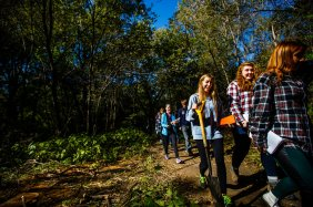 Students walk through Hidden Falls Park.