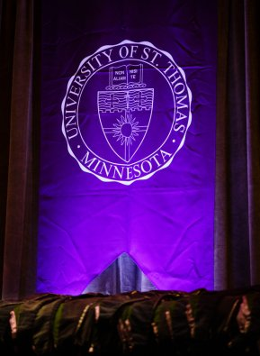 Graduate hoods sit below a St. Thomas seal during the School of Law Commencement ceremony May 13, 2017 at the Minneapolis Hilton.