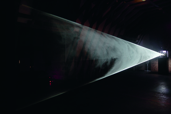 "Anthony McCall, ""Line Describing a Cone"" (1973), during the twenty-fourth minute. Installation view at the Musee de Rochechouart (2007). Photograph by Freddy Le Saux. Courtesy Sean Kelly Gallery, New York, Galerie Thomas Zander, Cologne, Galerie Martine Aboucaya, Paris."