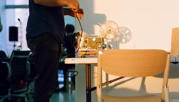 Paolo Davanzo (Echo Park Film Center) splicing film together at Tokyo's Blum&Poe Gallery.