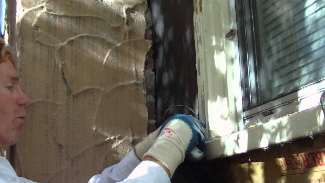 Waterproofing a brick or block chimney next to a stucco wall