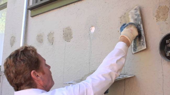 Basic home repairing of exterior insulation holes in stucco walls