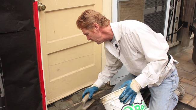Cementing a door threshold instead of replacing the wood one