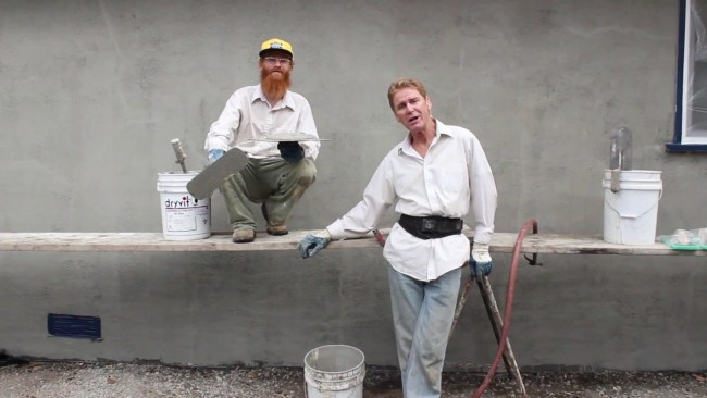 Rendering integrated sand and acrylic cement finish coats