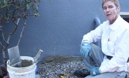 Fixing   excess stucco on bottom of wall caused by ground settling