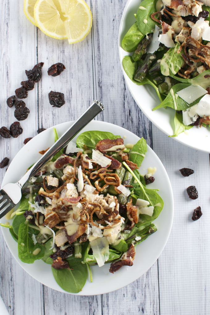 Spinach Salad with bacon, crispy shallots, chicken, and cherries.