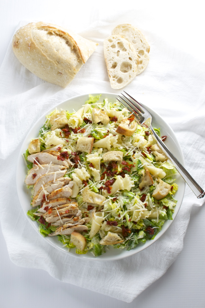 Parmesan Peppercorn Chicken Salad. This salad is packed full of delicous ingredients like sun dried tomatoes, romano cheese, homemade croutons and pasta! | stuckonsweet.com