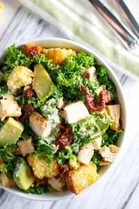 Kale Ceasar Salad with Chicken, Sun Dried Tomatoes, Avocado, and Cornbread Croutons | stuckonsweet.com