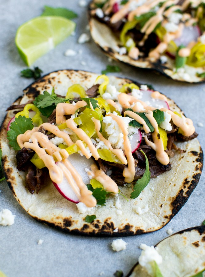 The slow cooker does all the work for these beef tacos!
