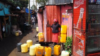 Woman selling drinking water.