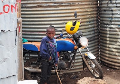 Boy with motorcycle.