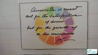 Sign in Pour Tous Distribution Center: Auroville is meant not for the satisfaction of desires but for the growth of the true consciousness. (The Mother, 1968)