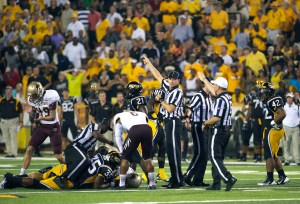 Referees signal for Texas State ball after USM fumbles a punt return during the fourth quarter.  Southern Miss had four fumbles and two interceptions during the game against Texas State. Christopher Little/Printz