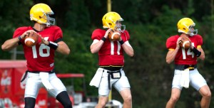 From left to right; senior Allan Bridgford, junior Cole Weeks and freshman Nick Mullens execute passing drills as the search for the starting quarterback continues duing a preseason practice at USM. Christopher Little/Printz