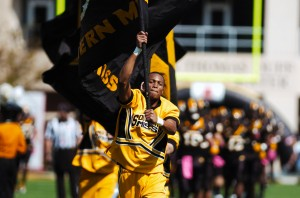 Junior Tyler Harris leads Southern Miss cheerleaders onto the field preceeding the game played against Louisville on Sept. 29, 2012. Mary Alice Truitt/Printz Archives