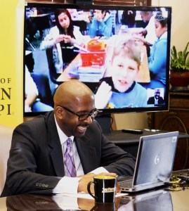 Rodney Bennett, president of The University of Southern Mississippi, chats via Skype with a middle school class in California to thank them for their donation to the Oseola McCarty Scholarship Fund. Michael Kavitz/Printz