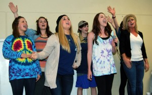 The ladies of Chi Omega dress up in their hippie attire as they perform karaoke night at Sigma Chi's philanthropy event, Derby Days. Mary Sergeant/Printz