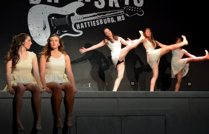 Dancers Suanne Messer, Alexis Barbaresi, Gabby Boudreaux, Blaire Roeling and Kaylin Wilson perform Wednesday night at a Brewsky's dance concert through the Repertory Dance Company. Alexandria Rodriguez