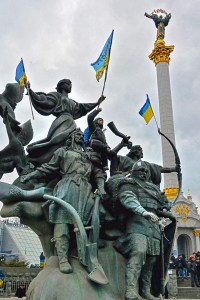 An anti-government protester positions himself on a monument of the city founders in Kiev, Dec. 5, 2013. Photo by David Bundy