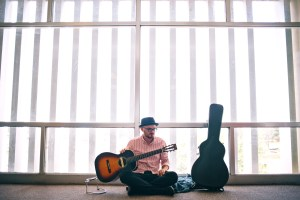 Jeremiah Stricklin sits with Mercedes, his Eastman Parlor guitar, in McLemore Hall at The University of Southern Mississippi. He graduated from Southern Miss in 2012 . Kate Dearman/Printz