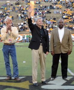 Mississippi Gov. Phil Bryant, with former USM running back Sammy Winder, waves to the crowd after being introduced before the game between the Southern Miss Golden Eagles and the Marshall Thundering Herd at M.M. Roberts Stadium in 2012. USA TODAY Sports Images