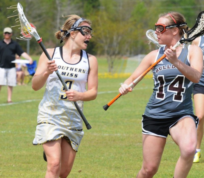 Myra Roebuck searches for an open pass during the lacrosse game against Mississippi State at Temple Baptist Church Saturday, April 5. The Eagles also played LSU earlier in the day. Michael Kavitz/Printz