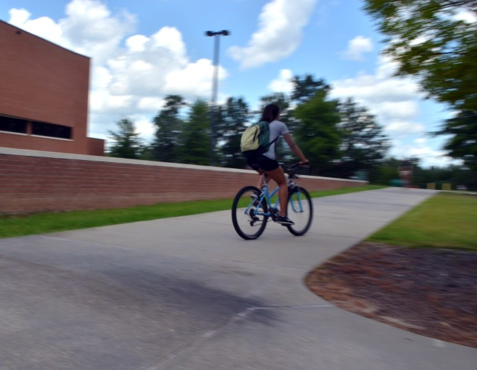 Sophomore Alina Martinez speeds off to her next class from the Theatre and Dance Building.