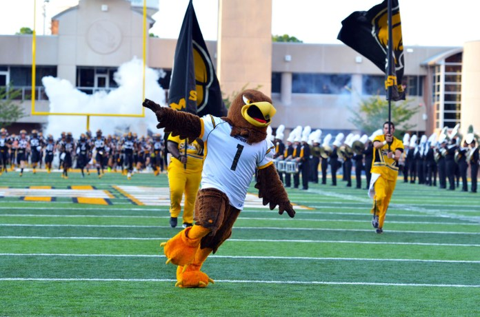 Seymour leads the Golden Eagles onto the field at the USM vs. Appalachian State game on Saturday. Southern Miss won 21-20 after an exciting last few minutes in which they blocked the Mountaineer's extra point. -Abby Smith