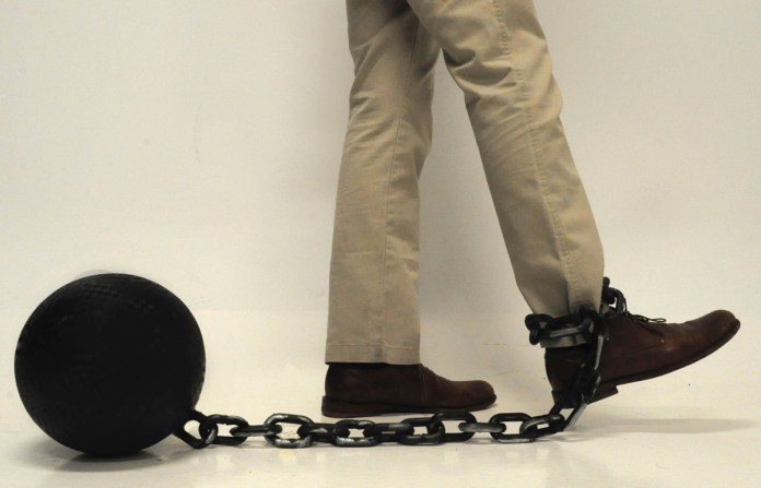 Ball and Chain: A photo illustration depicting how felony charges can keep you from obtaining jobs, loans, and a high quality of life. Model: Trey Stewart- A.J.Stewart/Printz