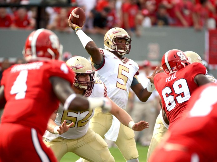 Sep 27, 2014; Raleigh, NC, USA;  Florida State Seminoles quarterback Jameis Winston (5) throws a pass during the first half  against the North Carolina State Wolfpack at Carter Finley Stadium.  Mandatory Credit: Rob Kinnan-USA Today Sports.