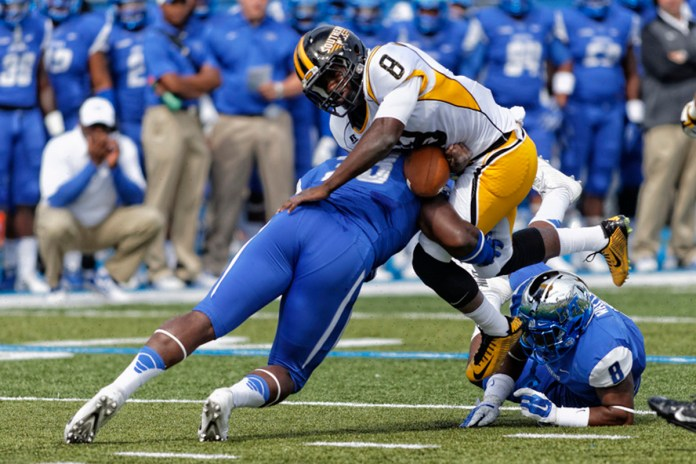 Running back Tez Parks struggles to get pass the Middle Tennesse defense on Saturday Oct. 4th. 2014.   The Golden Eagles fall on the road, 37-31. Greg French/MTSUSIDELINES