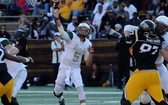 UAB quarterback Cody Clements passes against the Southern Miss defense as the Eagles host their last game of the season in Hattiesburg. The Blazers defeat the Golden Eagles, 45-24. This is the last season for the UAB football program due to the schools budget cuts. -Susan Broadbridge/Printz