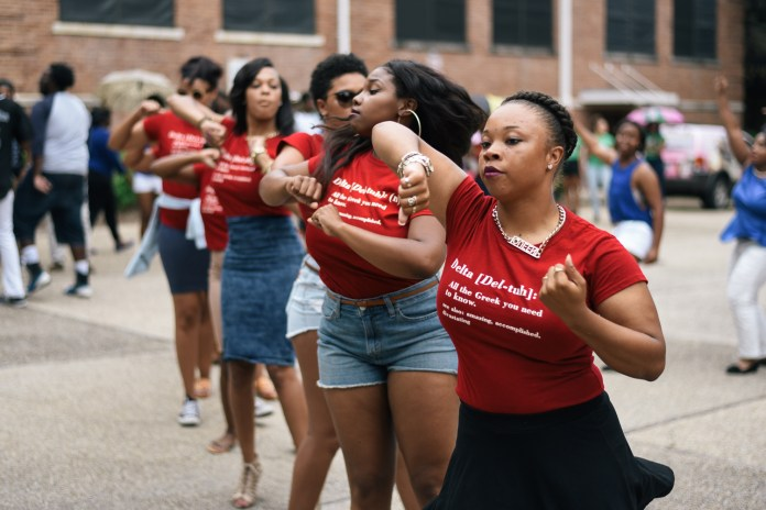 Gentler Mattox leads the Mu Nu chapter of Delta Sigma Theta Sorority, Inc in a strut at Coolin' With the Zetas back to school social, Wednesday August 19, 2015, which is the first NPHC event held this 2015-16 school year. Courtland Wells/ Student Printz
