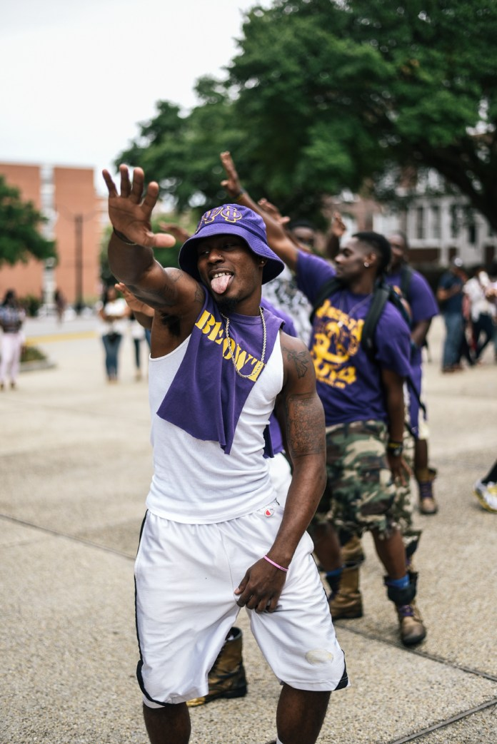 Jeremy Jackson leads the Nu Eta chapter of Omega Psi Phi Fraternity, Inc in a stroll at Coolin' With the Zetas back to school social, Wednesday August 19, 2015, which is the first NPHC event held this 2015-16 school year. Courtland Wells/ Student Printz