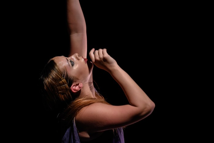 Taylor Krupp dances in 'tread away' during the Hub Dance Collective's 'In The Groove' presented on Friday, August 21, 2015. This was the third annual Hub Dance Collective concert.