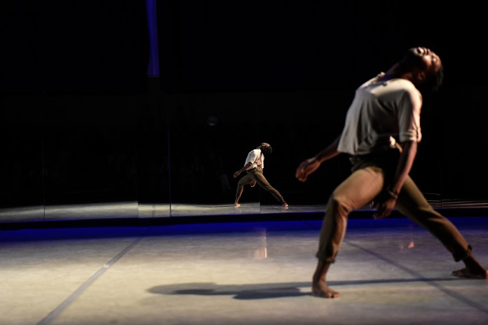 Tyler McCants dances in 'Anssemble the Emsemble' choreographed by Stacy Reischman Fletcher during the Hub Dance Collective's 'In The Groove' presented on Friday, August 21, 2015. This was the third annual Hub Dance Collective concert.
