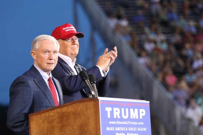 Donald Trump and Senator Jeff Sessions at Ladd-Peebles Stadium promoting his campaign for presidency in Mobile, Alabama August 21, 2015.