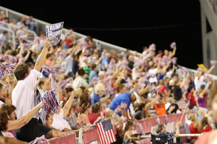 Supporters for Donald Trump cheer as he promotes the changes he will bring if he becomes president at the Ladd-Peebles Stadium in Mobile, Alabama August 21, 2015
