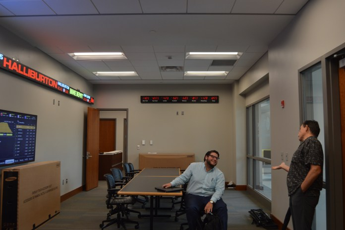 Professor Wayne Kelly and Senior, Double majoring in Finance and Business Management, Nick Algero talk after class in Scianna hall's Stock Exchange on the first day of class Wednesday, August 19th. Alexandria Rodriguez/Student Printz