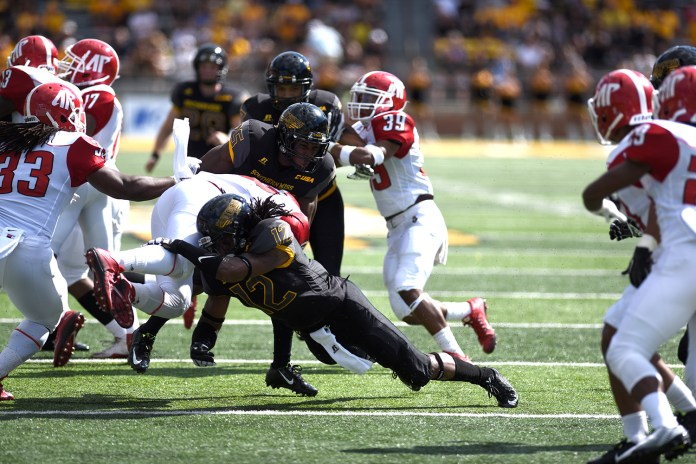 D'Nerius Antoine makes a tackle during a Austin Peay kick-off return. The Golden Eagles won against the Governors 52-6 Sept 12, 2015.