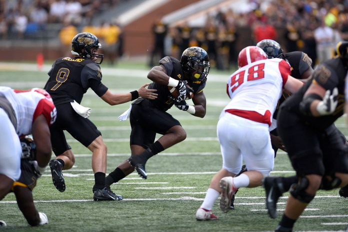 Justice Hayes takes a handoff from Nick Mullens against Austin Peay. The Golden Eagles won against the Governors 52-6 Sept 12, 2015.