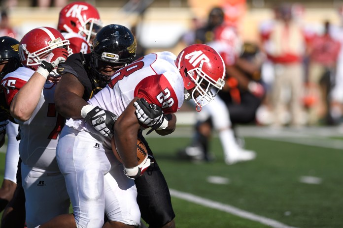 A Southern Miss defender tackles Taye Davis on a running play during the Golden Eagles second game of the season against Austin Peay. The Golden Eagles won against the Governors 52-6 Sept 12, 2015.