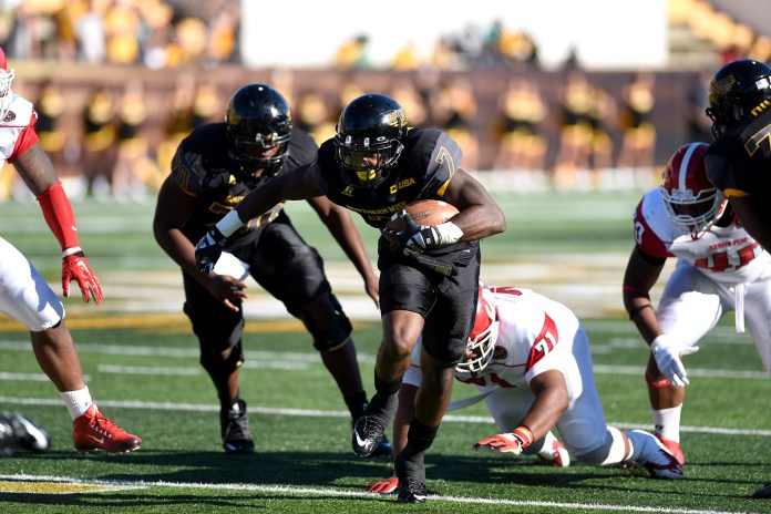 Justice Hayes runs past Austin Peay defenders during the second game of the season. The Golden Eagles won against the Governors 52-6 Sept 12, 2015.