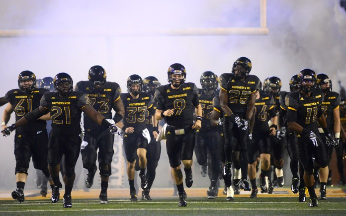 Southern Miss Golden Eagles enter the stadium before the game played against Mississippi State on Saturday night.  Mary Alice Weeks/Student Printz