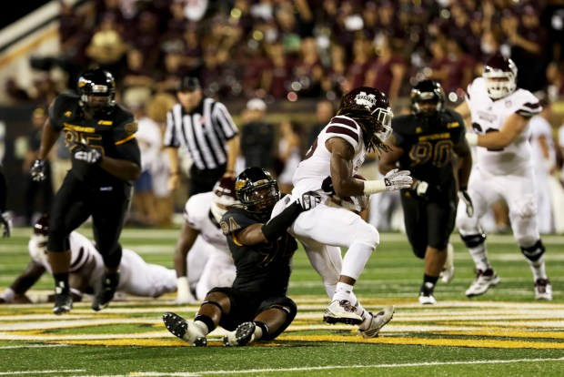 Southern Miss defensive lineman Dylan Bradley tackling a Mississippi State running back in Hattiesburg on Saturday night.